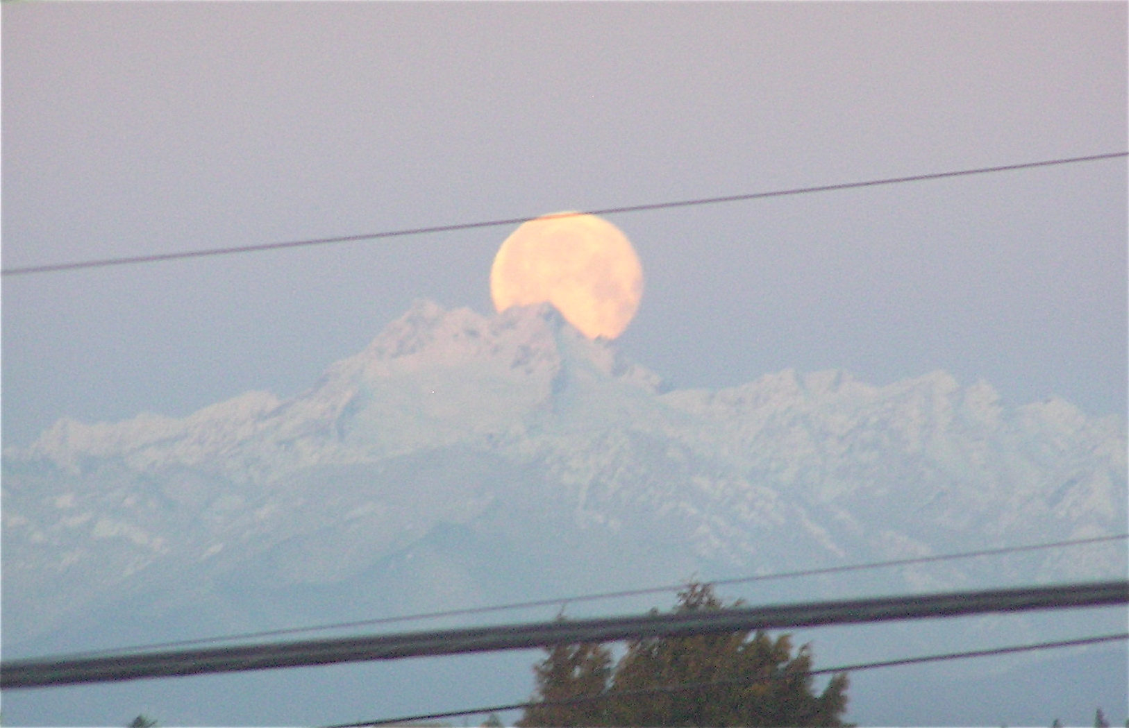 Moon setting over Olympic mountains