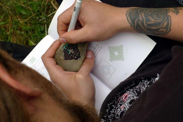 Painting designs on rocks